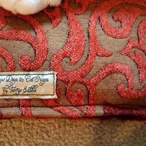Closeup of the tag and upholstery on a cat mat